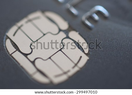 Close up of chip in credit card with shallow depth of field - stock photo