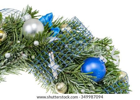 Close-up of Christmas balls on fir Christmas wreath (shallow DOF), isolated on white background - stock photo