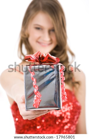 Close-up of Christmas present in femaleâ??s hand being given by smart girl