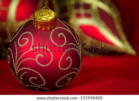 Close up of Christmas tree baubles in rich red and gold colors - stock photo