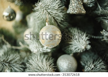 close up of christmas tree decorated with balls