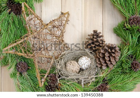 Close up of Christmas wreath decorated in country style - stock photo