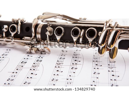 Close-up Of Clarinet And Musical Notes Isolated On White Background - stock photo