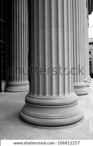 close-up of classic columns in black and white