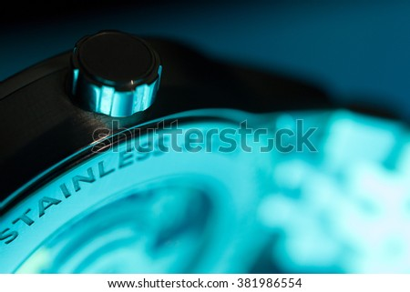 Close Up of Classic Swiss Watch with Aqua Glow - stock photo