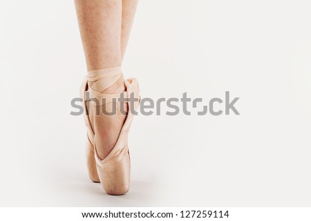 Close up of classical dancer's feet isolated on white background.