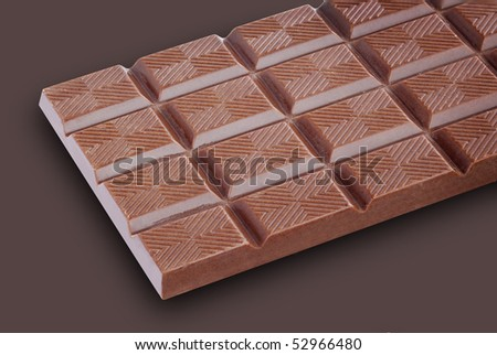 Close up of clean chocolate bar on brown background - stock photo