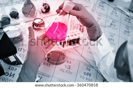 Close-up of clinician working with tools during scientific experiment in laboratory with chemical table background  - stock photo