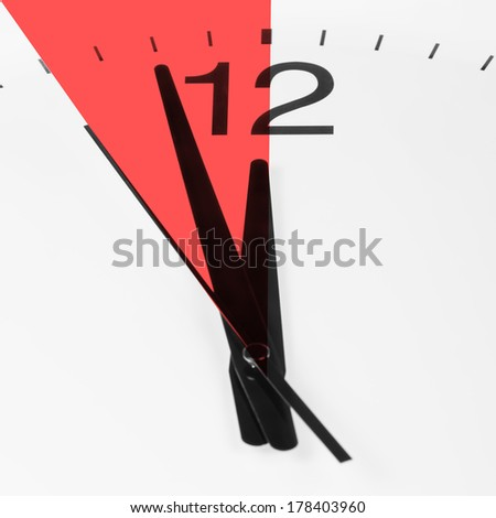 Close-up of clock face showing the hands at two minutes to midnight. Deadline concept - stock photo