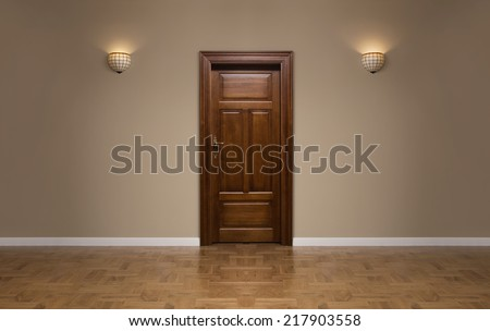 Close up of closed wooden door in the empty room with copy space - stock photo