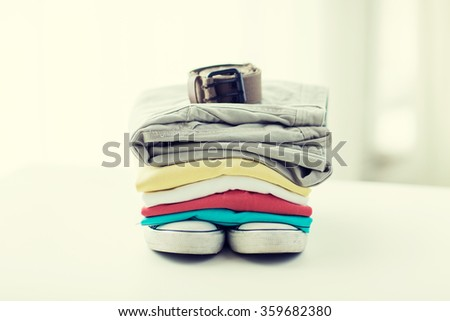 close up of clothes and accessories on table - stock photo