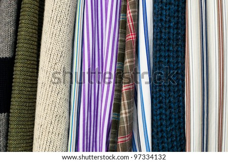 Close up of clothes hanging as a background image - stock photo