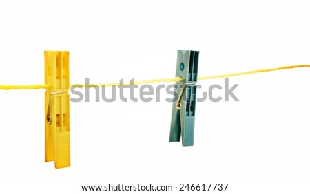 close up of clothespins on a line isolated on white