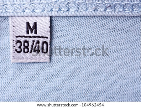 close-up of clothing label with M size - stock photo