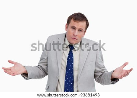 Close up of clueless businessman against a white background - stock photo