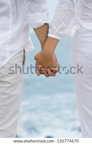 Close-up of clutched hands of lovers - stock photo