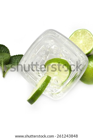 close up of cocktail glass with lime and ice,Cocktail with lime - stock photo