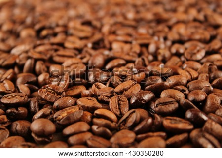 Close up of coffee beans scattered. Background