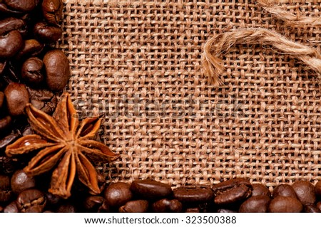 Close-up of coffee beans with spices in burlap sack  - stock photo