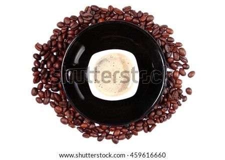 Close-up of coffee cup with roasted coffee beans . - stock photo