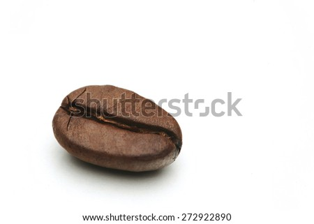 Close-up of coffee grains on white background - stock photo
