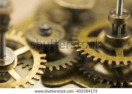 Close up of cogs from the inside of a clock