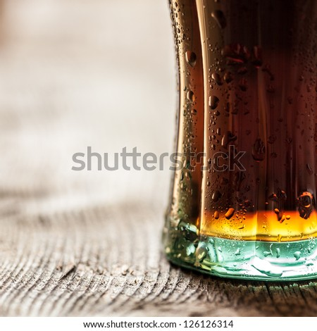 Close-up of cola in a glass on wooden table with copy space. - stock photo