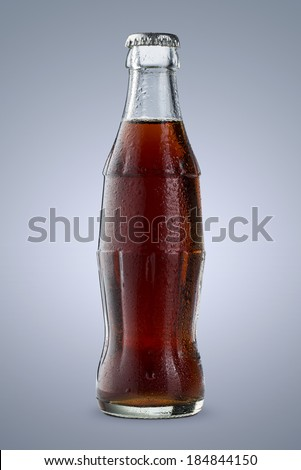 Close up of cold cola bottle isolated on blue background
