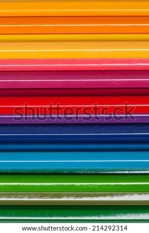 close up of color pencils on colorful background - stock photo