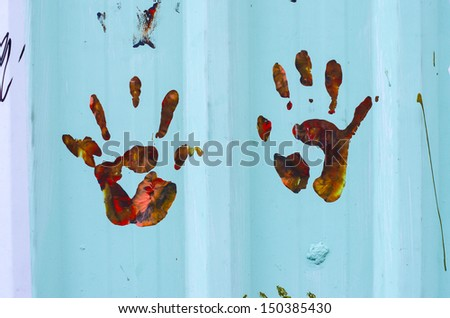 Close up of colored hand print on wall, Art on the streets. - stock photo