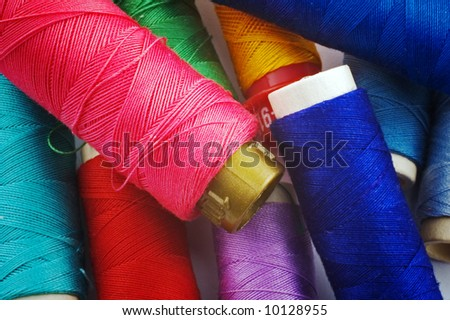 Close up of colored sewing spools