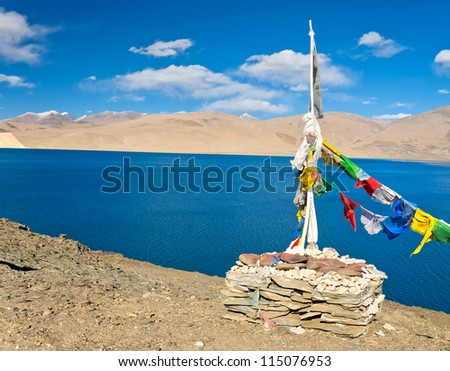 close up of colorful cloth with buddhist mantras decorated at bank of blue lake in ladakh, leh, India