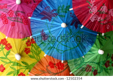 Close up of colorful cocktail umbrellas perfect for background