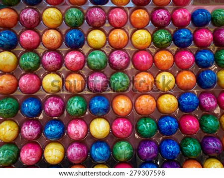 Close up of colorful creative Easter eggs in a tray - stock photo