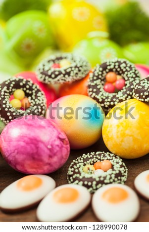 Close up of colorful easter eggs and sweets - stock photo