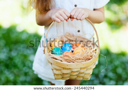 Close up of colorful Easter eggs in a basket - stock photo