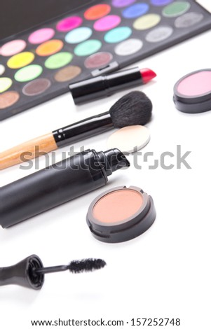 close up of colorful make-up products isolated on white background