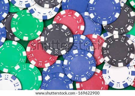 close up of colorful poker playing chips on the table