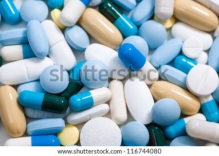 Close up of colorful tablets and capsules - stock photo