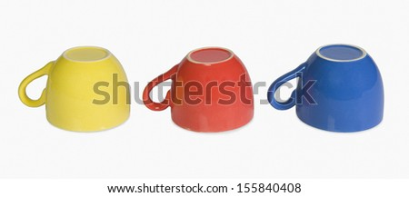 Close-up of colorful tea cups in a row - stock photo