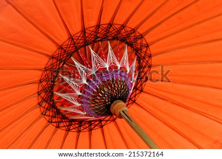 Close up of colorful umbrellas with wooden handle - stock photo