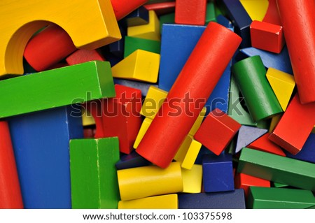 Close-up of colorful wooden building blocks - stock photo
