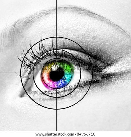 Close-up of colourful human eye and target - stock photo