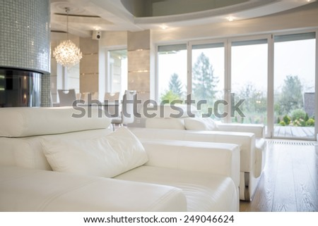 Close-up of comfortable armchairs in luxury interior - stock photo