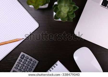 Close-up of comfortable working place on wooden background, top view - stock photo