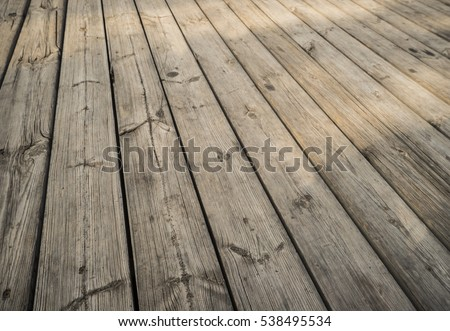 Close up of composite decking. Wood planks. Kiln dried wooden lumber texture background. Timber hardwood wall.(selective focus)