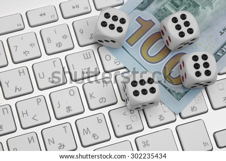 Close-up Of Computer Keyboard With Gaming Dices. Gambling Game Concept - stock photo