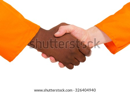 close up of construction workers handshake on white background - stock photo