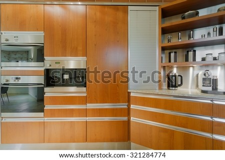 Close up of contemporary design kitchen interior with wooden furniture - stock photo