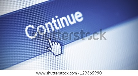 close-up of continue button on computer screen - stock photo